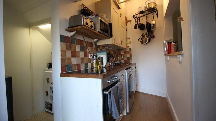 Kitchen & Storage Area (s)